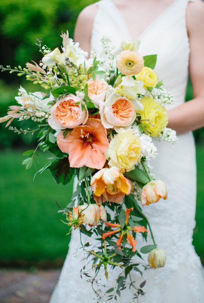 Amaryllis, garden roses, ranunculus, lily of the valley, and daffodil bouquet designed by Frontier Flowers of Fontana.  At Black Point in Lake Geneva, Wisconsin.  Photo Graciously Provided by: Kristina Lorraine