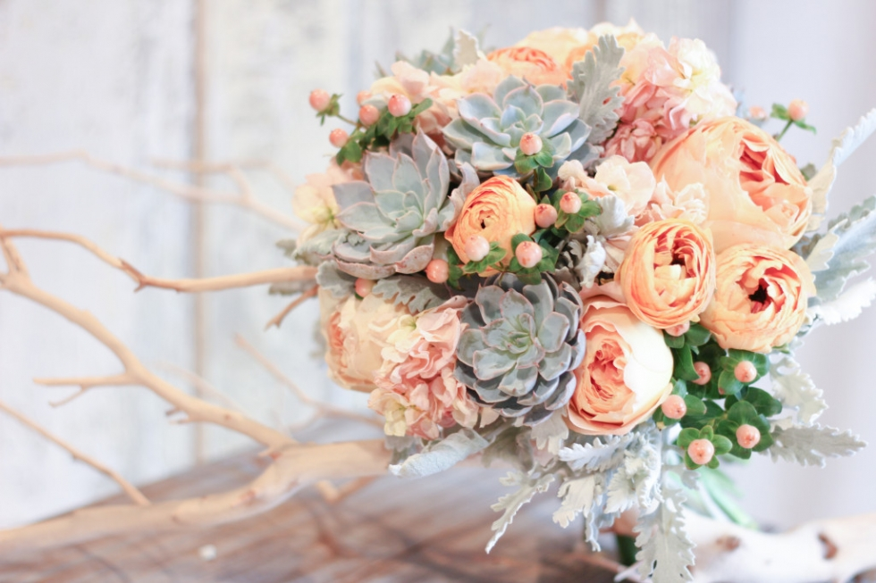 Succulents, Garden Roses, Berries, and Dusty Miller Bouquet Designed by Frontier Flowers of Fontana.