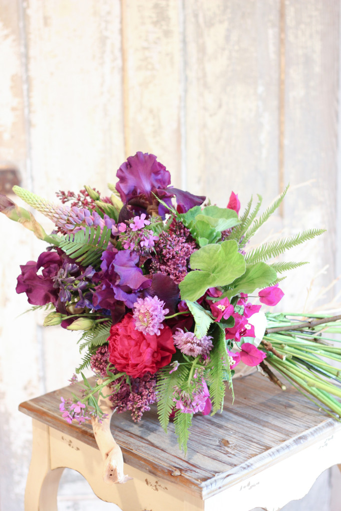 Bouquet of German bearded iris, lilacs, peonies and lupine designed by Frontier Flowers of Fontana.