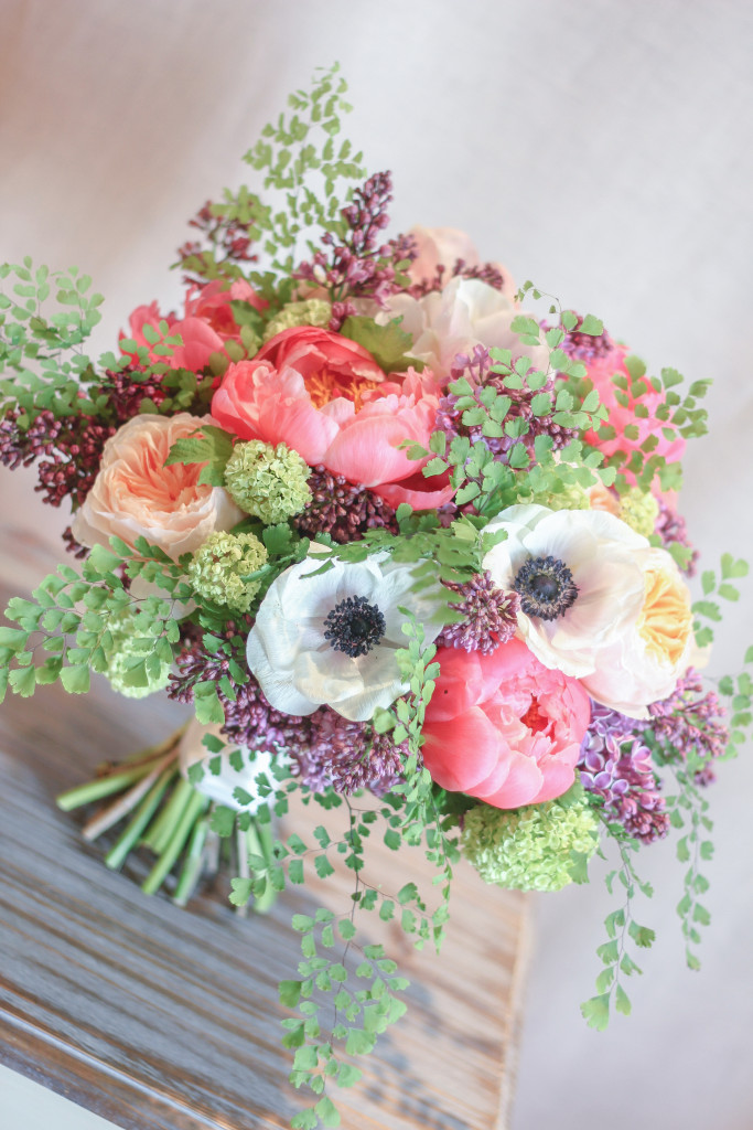 Bouquet of peonies, garden roses, anemone, and lilac designed by Frontier Flowers of Fontana.