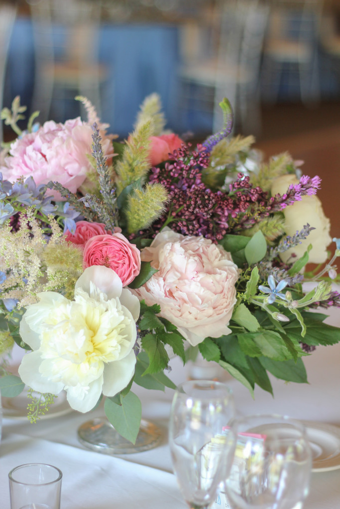 A lovely compote of peonies, lilacs, tweedia, lavender, and astillbe designed by Frontier Flowers of Fontana.  At Abbey Springs Country Club in Fontana, Wisconsin